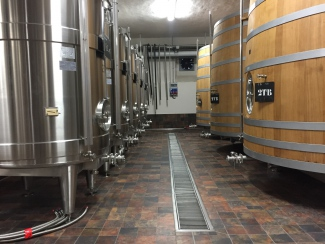 Stainless-steel and wooden tanks in Louis Roederer winery